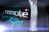Businessman pointing to word remote — Stock Photo