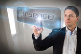Businessman pointing to word presencece — Stock Photo