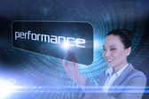 Businesswoman pointing to word performance — Foto de Stock