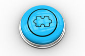 Jigsaw graphic on blue button — Stock Photo