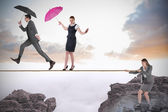 Young businesswoman pulling a tightrope for business people — Stock Photo