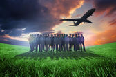 Business people standing up with airplane — Stock Photo
