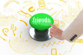 Friends against digitally generated green push button — Stock Photo