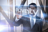 Businessman presenting the word novelty — Stock Photo