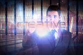 Businessman presenting the word creative — Stock Photo