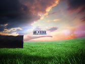 Business people standing up against green field — Foto Stock