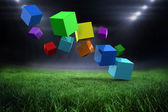 Colourful cubes against football pitch — ストック写真