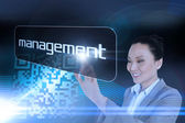 Businesswoman pointing to word management — Stock Photo