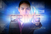 Businesswoman presenting the word crime — Stock Photo