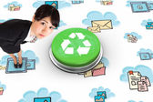 Serious businesswoman against recycling symbol — Stock Photo