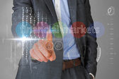 Businessman touching the words financial markets — Stock Photo