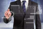 Businessman pointing finger at interface — Stock Photo