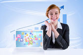 Excited redhead businesswoman sitting at desk — Stock Photo