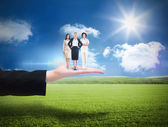 Businesswomen against sunny green landscape — Stock Photo