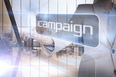 Businesswoman presenting the word campaign — Stockfoto