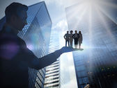 Composite image of businessman holding business team — Stock Photo