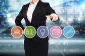Businesswoman pointing to business app buttons — Stock Photo