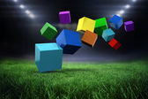 Colourful cubes against football pitch — Стоковое фото