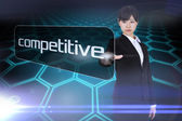 Businesswoman pointing to word competitive — Stock Photo