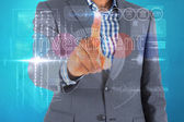 Businessman touching the word invest on interface — Stock Photo