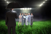 Businessman against football pitch — Stock Photo