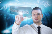 Businessman pointing to word framework — Stock Photo