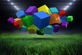 Colourful cubes against football pitch — Stockfoto