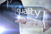 Businessman presenting the word quality — Stock Photo