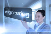 Businesswoman pointing to word engineering — Stock Photo