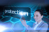 Businesswoman pointing to word protection — Stock Photo