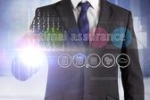 Businessman touching the words optimal assurance — Stock Photo