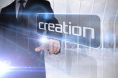 Businessman presenting the word creation — Stock Photo