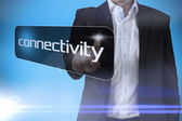 Businessman pointing to word connectivity — Stock Photo