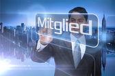 Businessman presenting the word member in german — Stock Photo