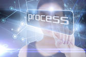 Businesswoman pointing to word process — Stock Photo