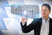 Businessman pointing to word internet — Stock Photo