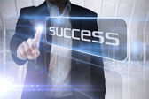Businessman presenting the word success — Stock Photo