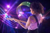 Girl playing guitar — Stock Photo