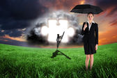 Businesswoman holding umbrella — Stock Photo