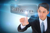 Businessman pointing to word software — Stock Photo