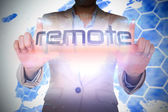 Businesswoman presenting the word remote — Stockfoto