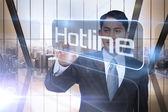Businessman presenting the word hotline — Stock Photo