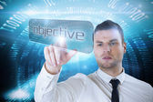 Businessman pointing to word objective — Stock Photo