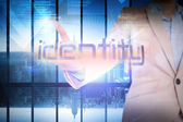 Businesswoman presenting the word identity — Stock Photo