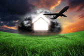 Airplane against green field — Stock Photo
