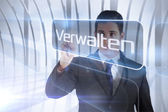 Businessman presenting the word manage in german — Stock Photo