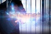 Businessman presenting the word internet — Stock Photo