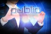 Businesswoman presenting the word public — Stock Photo
