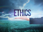Businesswomans hand presenting the word ethics — Stock Photo