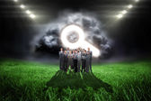 Business team against football pitch — Stock Photo